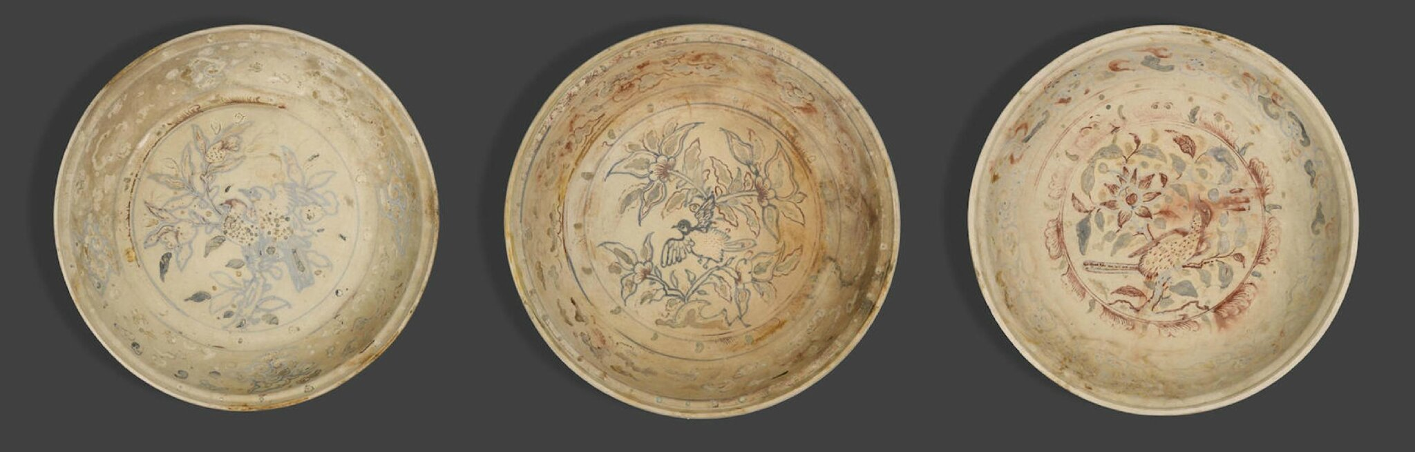 A group of three large underglaze blue and enameled dishes, Vietnam, late 15th-early 16th century
