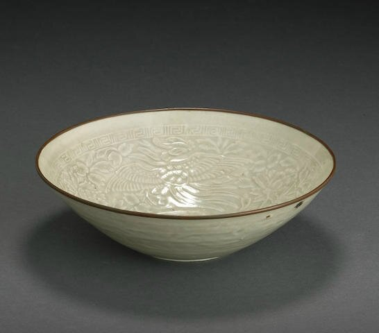 A molded qingbai bowl imitating Dingyao, Song-Yuan dynasty, 13th-14th century