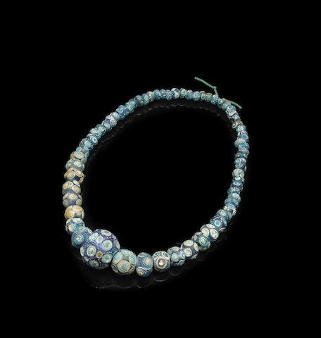 A collection of sixty-five glass 'eye' beads, Zhou dynasty