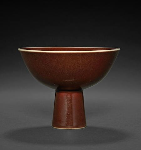 A fine copper red-glazed stem bowl, Qianlong six-character mark and of the period