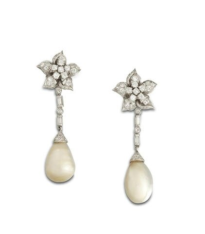 A pair of natural pearl and diamond pendent earrings, circa 1950