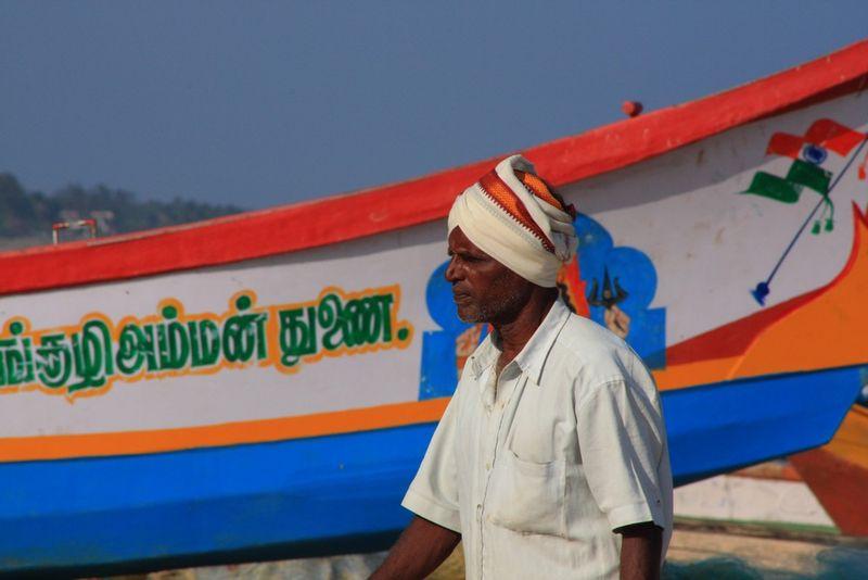 Pêcheur et bateau