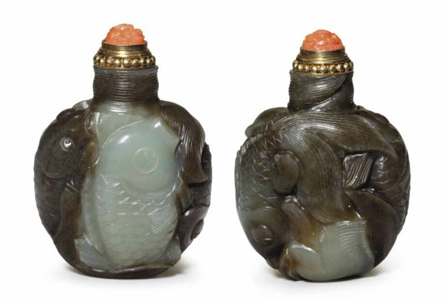 A well-carved brown and pale greenish-white jade 'carp' snuff bottle, 1789-1850