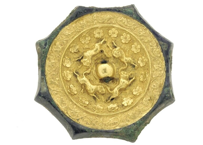 Octagonal mirror with animals, flowerets, and floral scrolls, China, early or mid-Tang dynasty, late 7th–first half of 8th century
