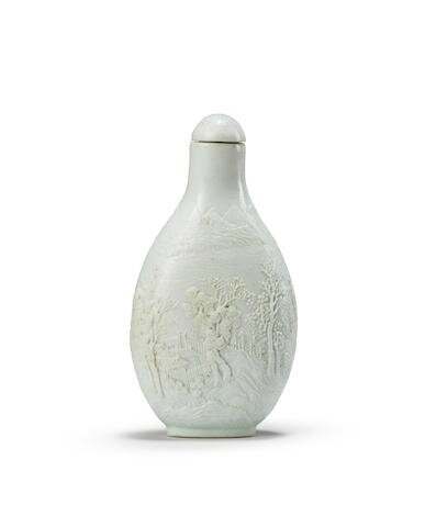 A carved very pale turquoise-glazed snuff bottle, Chen Guozhi four-character mark, circa 1820-1860
