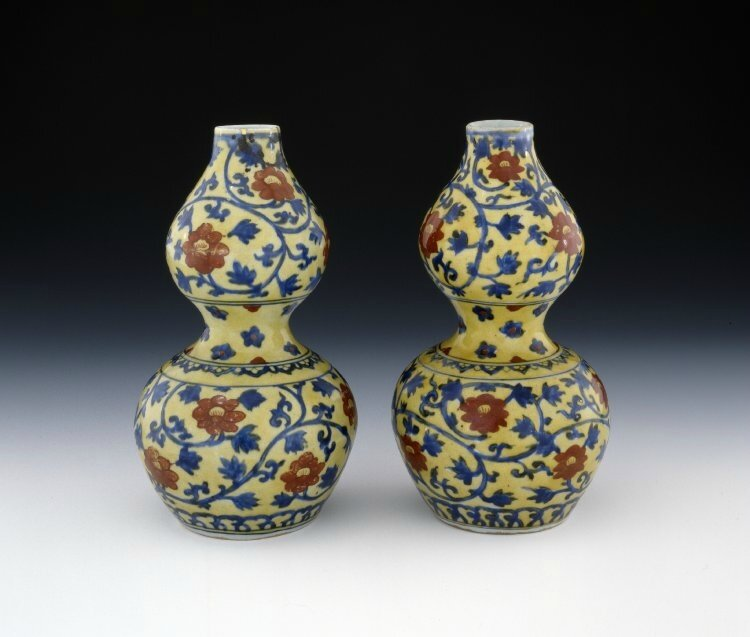 Two double-gourd-shaped porcelain bottles with underglaze blue, overglaze red and yellow decoration, Ming dynasty, Jiajing six-character mark in a double ring in underglaze blue and of the period (1522-1566)