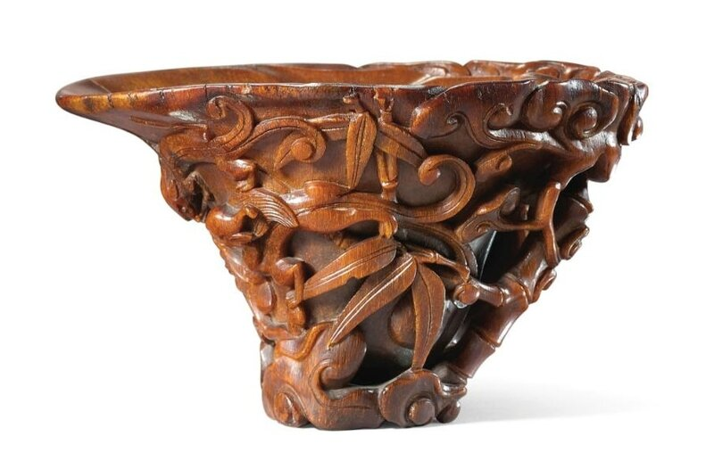 A finely carved rhinoceros horn 'Chilong and Lingzhi' libation cup, 17th century