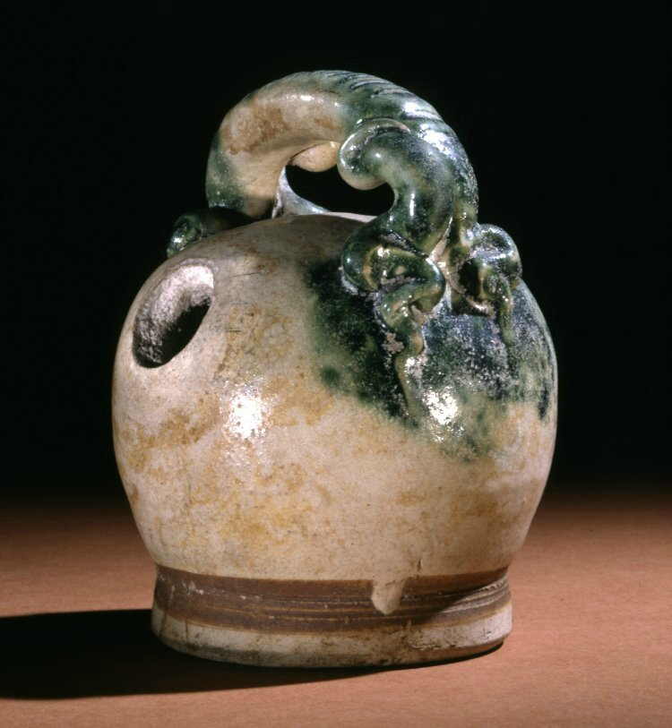 Lime pot, 14thC-15thC, Vietnam. Made of green glazed stoneware. Height: 4.5 inches. Donated by Sir Herbert Ingram, 2nd Baronet. 1928,1116.1. British Museum © The Trustees of the British Museum.