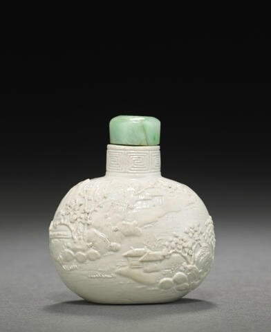 A glazed porcelain snuff bottle carved with figures and landscape, 1820-1860