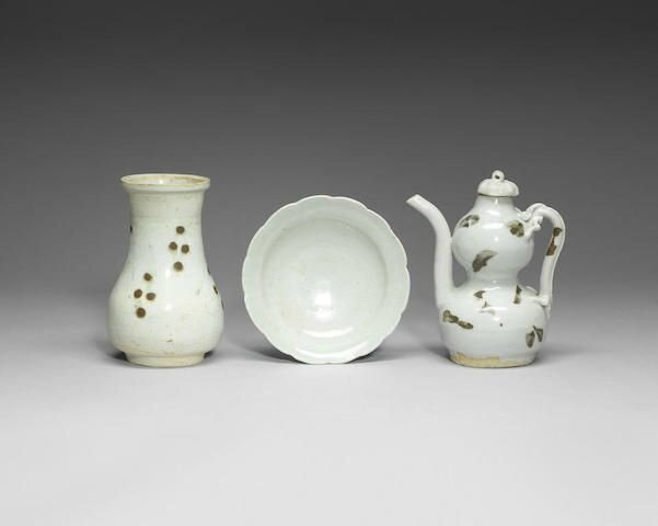 A small brown iron-splashed Qingbai double-gourd ewer and cover, Yuan Dynasty