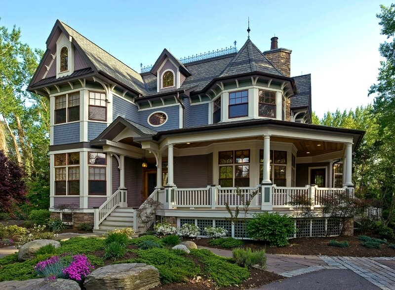 Flat-roof-homes-exterior-victorian-with-oval-window-beige-stair-railing