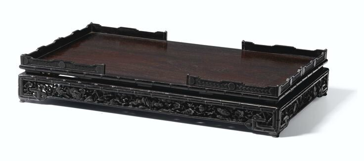 A finely carved Imperial zitan stand, Qing dynasty, Qianlong period
