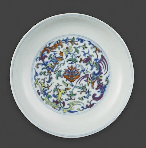 A doucai-decorated dish with phoenix, kui dragon and floral decoration, Qianlong six-character mark and of the period