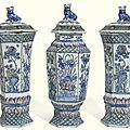 A garniture of three dutch delft polychrome vases and covers, early 18th century