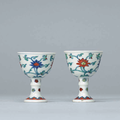 A pair of small Chenghua-style doucai stem cups, Qing dynasty, 18th century