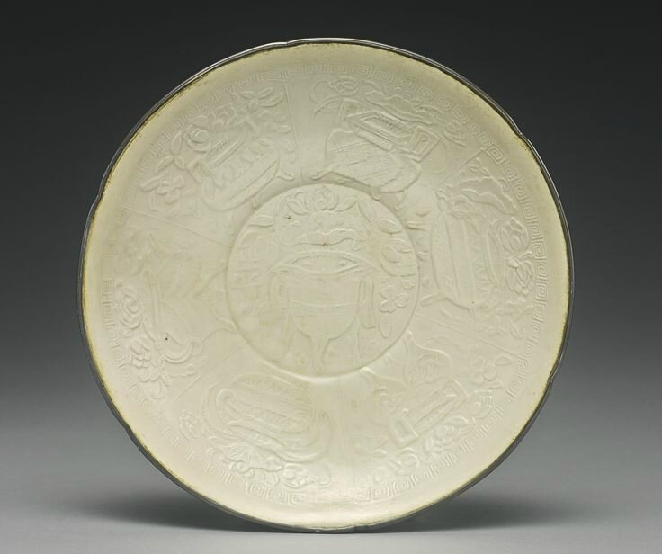 A molded 'Ding' dish, Northern Song dynasty