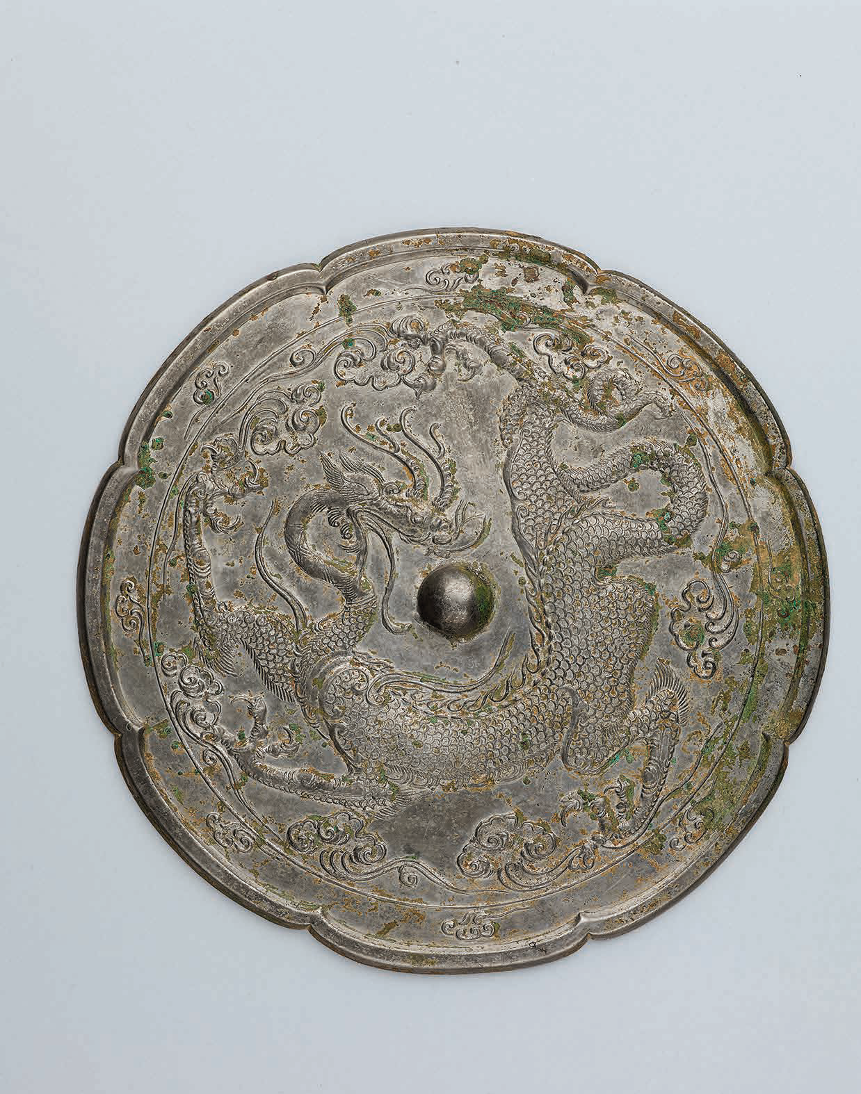 A bronze octalobed 'Dragon' mirror, Tang dynasty (618-307)