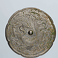 A bronze octalobed 'dragon' mirror, tang dynasty (618-307)
