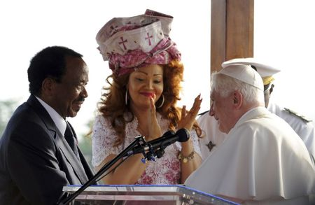 1_pope_benedict_xvi_speaks_to_cameroon_s_president_paul_biya_as_biya_s_wife_chantal_applauds_at_the_international_airport_in_yaounde_23