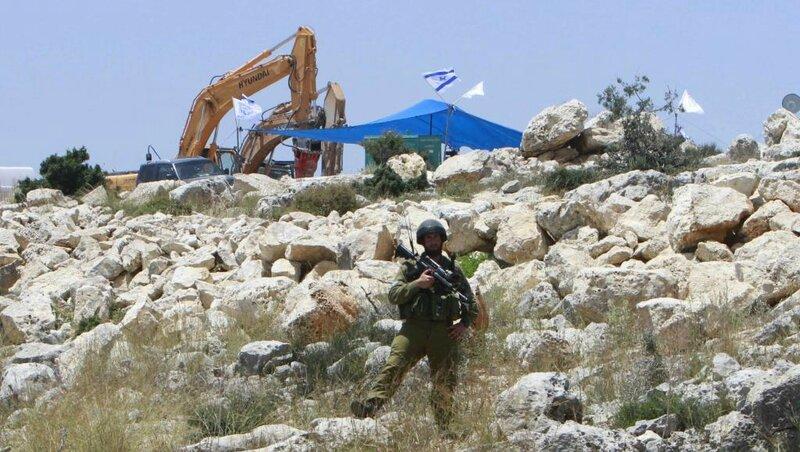2014-05-28T162153Z_1868409288_GM1EA5T00RQ01_RTRMADP_3_ISRAEL-PALESTINIAN-SETTLEMENT_0