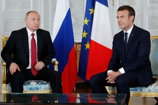french-president-emmanuel-macron-meets-with-russian-president-vladimir-putin-at-the-chateau-de-versailles-before-the-opening-of-an-exhibition-marking-