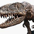 A massive bronzed fibreglass model of a tyrannosaurus rex