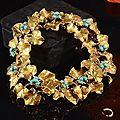 Jean-claude champagnat, probablement pour christian dior. un important bracelet en or jaune, à motifs de feuilles de trèfles