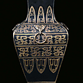 A porcelain vase bronze and gold imitation with relief archaic decoration, China, Qing Dynasty, 19th century