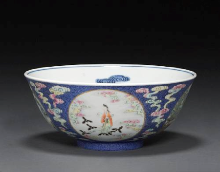 A_sgraffito_blue_enamel_ground_porcelain_bowl_with_underglaze_blue_and_famille_rose_enamel_decoration