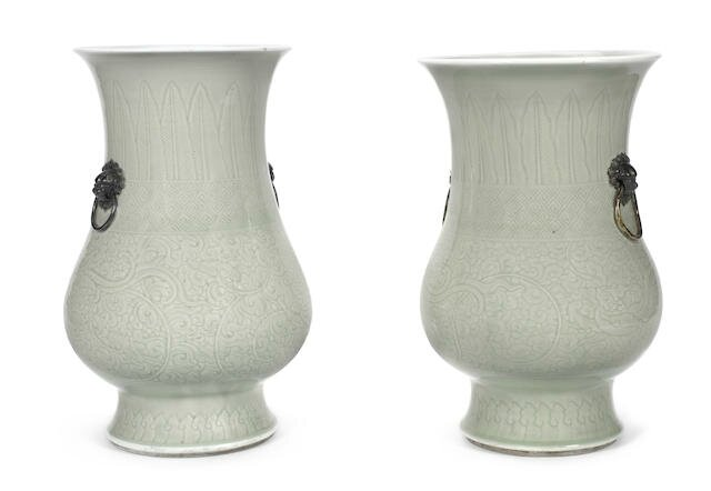 A pair of carved celadon-glazed 'chilong' vases, zun, Kangxi period (1662-1722)
