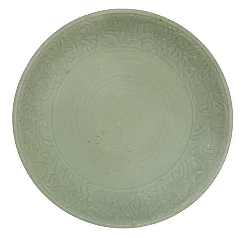A large Longquan celadon-glazed carved 'peony' dish, 14th-15th century