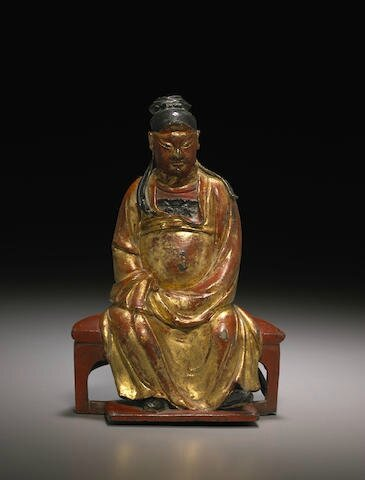 A gilt and polychrome-lacquered figure of Daoist divinity, Late Ming dynasty