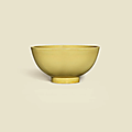A yellow-glazed bowl, Kangxi six-character mark in underglaze blue within a double-circle and of the period (1662-1722)