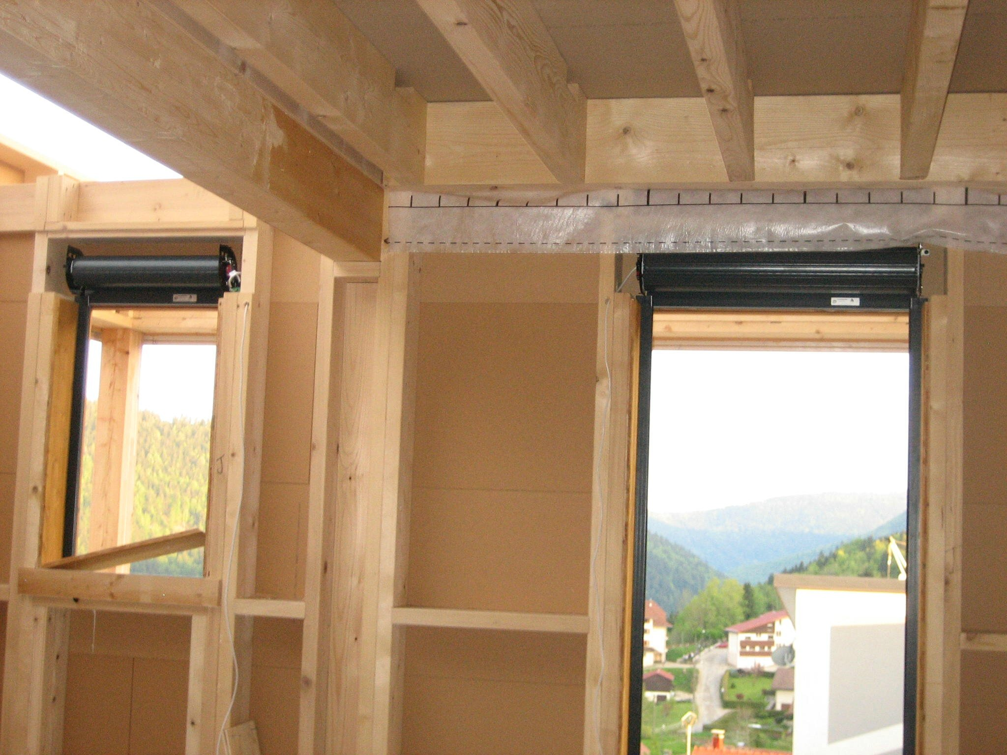 Installation volet roulant bois for Pose de volets roulants