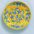 Imperial yellow-ground blue and white saucer dish. Six character mark of Zhengde within a double ring and of the period