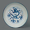 A large blue and white 'dragon' dish, jiajing six-character mark in underglaze blue and of the period (1522-1566)