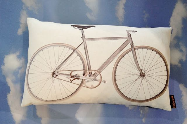 Ella Doran Bike cushion and aeroplanes flat wrap at maison objet © ella doran