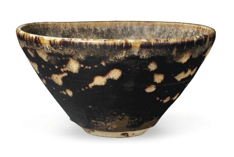 A Jizhou resist-decorated papercut conical bowl, China, Southern Song Dynasty, 12th-13th century