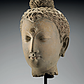 A life-size stucco head of buddha, gandhara, 3rd-4th century