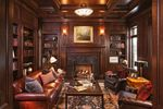 New-Traditional-Living-Designs-with-ark-paneled-library-complete-with-beautiful-books-comfortable-leather-furniture-and-brass-accents