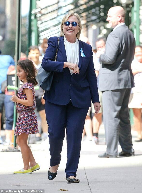 Hillary Clinton photo op on sept 11 with girl standing by