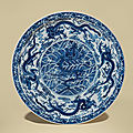 A large blue and white 'nine dragons' dish, yongzheng six-character mark within double circles and of the period (1723-1735)