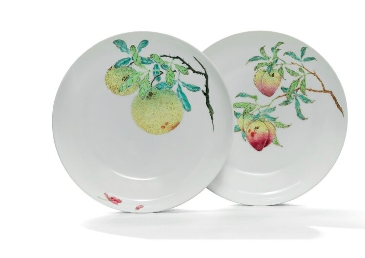 A rare pair of famille rose 'fruit' dishes, Yongzheng six-character marks in underglaze blue within double circles and of the period (1723-1735)