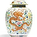 A 'famille-rose' 'dragon and phoenix' vase and cover, jiaqing seal mark and period