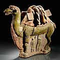 A green-brown glazed pottery group of a camel with a calf, sui-tang dynasty, 7th century