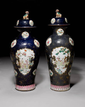 A_massive_pair_of_famille_rose_powder_blue_ground_baluster_vases_and_covers