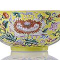 An extremely rare imperial 'famille rose' bowl with exotic flowers on a yellow ground. qianlong mark and period