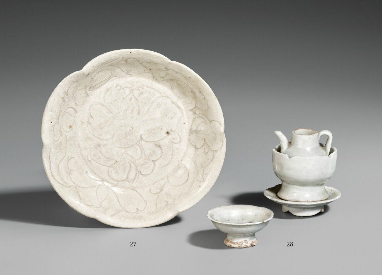 A shallow Qingbai dish. Song dynasty & A miniature Qingbai ewer, warmer, stand and a stem cup. Southern Song dynasty