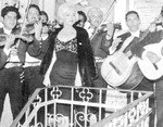 1962_02_Mexico_blackDress_010_Party_010wMariachis_1