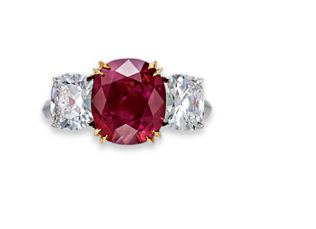 A three-stone ruby and diamond ring